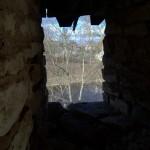 Порховская крепость. Вид на Шелонь из бойницы боевого хода.