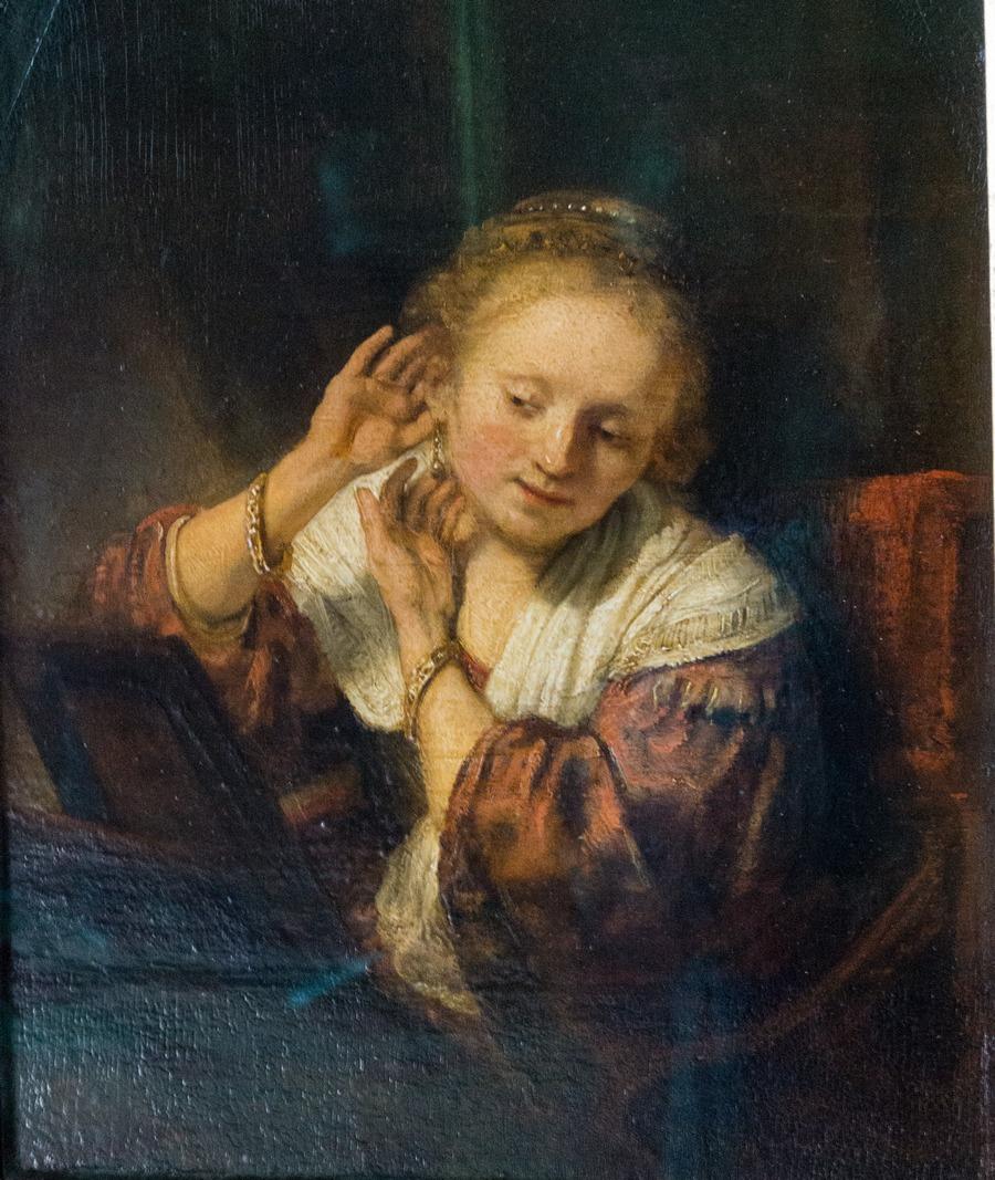Молодая женщина, примеряющая серьги. 1657. Государственный Эрмитаж. Санкт-Петербург. Поступила в Эрмитаж из собрания Бодуэна в Париже в 1781 г.